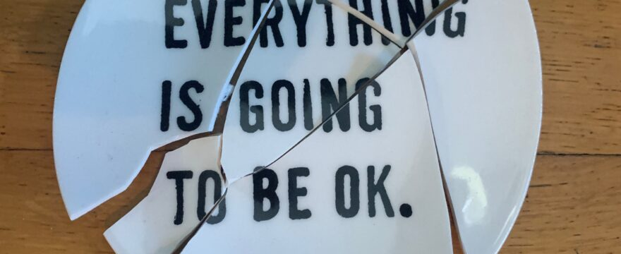 """Broken plate with the words """"Everything is going to be OK."""""""